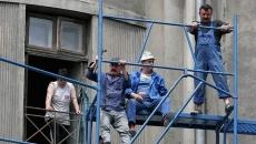 muncitori români exploataţi