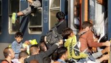 Imigranţi, tren