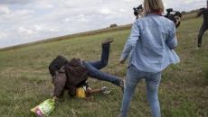 Operatoare din Ungaria loveşte imigranţi