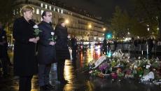Francois Hollande şi Angela Merkel în Place de la République